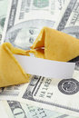 Fortune cookie with money Royalty Free Stock Photo