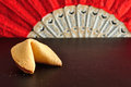 Fortune cookie and a red hand fan Royalty Free Stock Photo