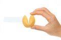 Fortune cookies in hand with blank slip Royalty Free Stock Photo