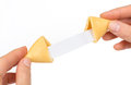 Fortune cookies in hand Royalty Free Stock Photo