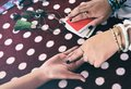 Fortune teller reading fortune lines on hand Palmistry Psychic readings and clairvoyance hands concept - Tarot cards divination Royalty Free Stock Photo