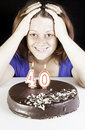 Forty birthday girl with cake in celebration Royalty Free Stock Photos