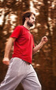 Forty years old caucasian man running workout autumn forest Royalty Free Stock Photo