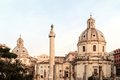 Forum traianum view on the traian in the morning hours with its great column and the cupola in rome italy Royalty Free Stock Image