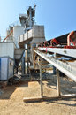 Forward activity at concrete plant manufacturing process of the in daytime Stock Photos