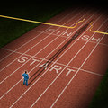 Forward thinking business concept for success acceleration with a businessman standing on the start line in a track and feild path Stock Photos
