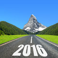 Forward to the new year asphalted road in mountain landscape Stock Photography