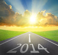 Forward to new year concept asphalt road with arrow date and beautiful sunset and sunshine Stock Images