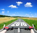 Forward to the new year cyclist riding a bike Royalty Free Stock Photo