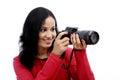 Fotógrafo de la mujer joven que toma imágenes Imagen de archivo libre de regalías