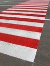Fot- röd vägsebra för asfalt Royaltyfria Foton
