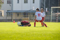 Foul in football match boys kicking on the sports field Royalty Free Stock Photo