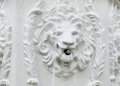 Fountain in bas relief of lion a Stock Photos