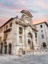 Fountain and clock tower in spoleto italy old of piazza del mercato with the artistic ancient umbria Stock Image