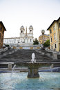 Fountain and detail of the spanish steps in rome italy Stock Photos