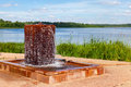 Fountain with drinking water at the lake in sunny day summer Royalty Free Stock Images