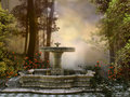 Fountain in the forest old stone foggy Royalty Free Stock Image