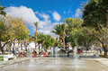 Fountain and horse carriages in town square of Mijas. Malaga pro Royalty Free Stock Photo