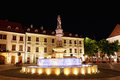The fountain with illumination on a central square at night in Bratislava