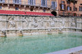 Fountain of joy - a medieval marble fountain in Siena. Panel Fonte Gaia, Piazza del Campo, Siena, Tuscany Royalty Free Stock Photo