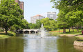 Fountain,lake, building and plants Royalty Free Stock Photography