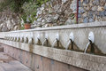 Fountain with lion heads of mountain spili crete Stock Images