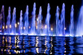 Fountain in the night Stock Photos