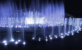 Fountain night blue urban scene illuminated by light in a park in moscow russia by evening or with streetlamps at the Royalty Free Stock Images