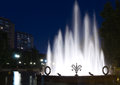 Fountain night city in a park in moscow by evening illuminated by streetlamps Stock Photo