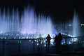 Fountain night people photographer urban scene in a park in moscow russia by evening with a guy who is shooting his girl friend Stock Images
