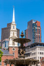 Fountain in park street with the steeple of old north church boston Stock Photography