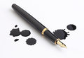 Fountain pen and ink spots on white background Stock Image