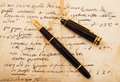 Fountain pen on letter with cap an antique Stock Photography