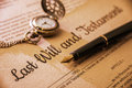 Fountain pen, a pocket watch on a last will and testament. Royalty Free Stock Photo