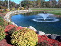 Fountain and pond at fall season Royalty Free Stock Photo