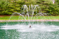 Fountain in pond at summer Royalty Free Stock Images