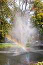 Fountain with rainbow in the park of czestochowa poland Stock Photography