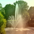Fountain and rainbow in riga canal latvia park with gardens fountains Stock Images