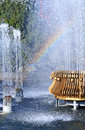 Fountain with rainbow water splashing a on a summer day Stock Photography