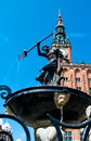 Fountain with a statue of neptune in the background the town hall gdansk poland Stock Image