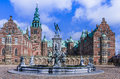 Fountain with statues in front of Frederiksborg Palace, Denmark