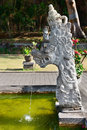 Fountain traditional balinese stone dragon image statue goa lawah bat cave temple bali indonesia Stock Image
