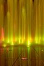 Fountain yellow light streams of water Royalty Free Stock Photos