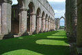 Fountains abbey england ruins in yorkshire viewed off centre Royalty Free Stock Photo