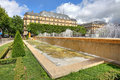 Fountains green lawns typical parisian building around famous hotel de ville paris france Royalty Free Stock Photography