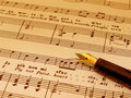 Fountian Pen atop sheet music (sepia toned) Royalty Free Stock Photo