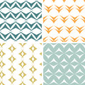 Four abstract arrow shapes seamless patterns set vector in matching color scheme Royalty Free Stock Images