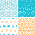 Four abstract blue yellow floral shapes seamless patterns set vector in matching color scheme Stock Image