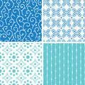 Four abstract doodle motives seamless patterns set vector in matching color scheme Royalty Free Stock Images
