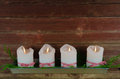 Four advent candles at an old weathered red wall Royalty Free Stock Photo